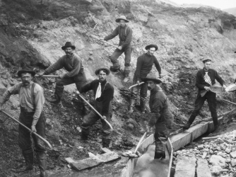 Miners panning and digging during the Klondike gold rush.
