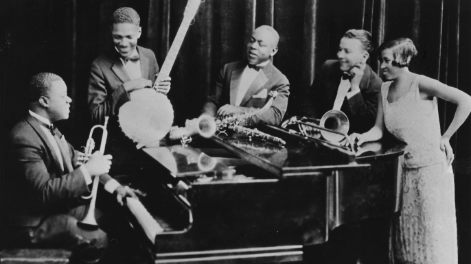 Louis Armstrong and his Hot Five band—his then-wife Lil is on the right. (Credit: Gilles Petard/Redferns)