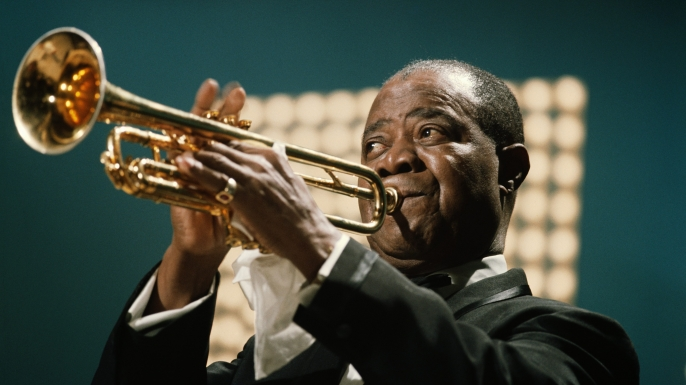 Louis Armstrong performing in June 1967. (Credit: David Redfern/Redferns)