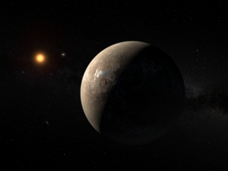 This artist's impression shows the planet Proxima b orbiting the red dwarf star Proxima Centauri, the closest star to the Solar System. The double star Alpha Centauri AB also appears in the image between the planet and Proxima itself. Proxima b is a little more massive than the Earth and orbits in the habitable zone around Proxima Centauri, where the temperature is suitable for liquid water to exist on its surface. (Credit: ESO / M. Kornmesser)