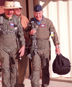 Hoover (left) walks with Chuck Yeager in October 1997, when Hoover once again flew the chase plane as Yeager recreated his sound barrier-breaking flight.