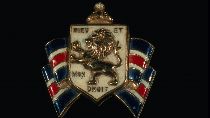 "The British Coat of Arms bearing the motto ""Dieu et mon droit."""
