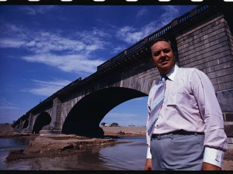C.V. Wood, president of the McCulloch Corporation standing under the almost London Bridge near Lake Havasu City. (Credit: Bettmann / Getty Images)