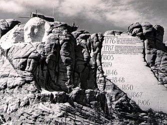 Mount Rushmore as carving began with conceptual drawing of Borglum's idea for a the never-built entablature inserted. (Credit: NPS, Mount Rushmore National Memorial)