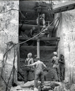 Workers in the early stages of constructing the Hall of Records. (Credit: Charles D'Emery photo, courtesy of NPS, Mount Rushmore National Memorial)