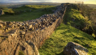 A stretch of Hadrian's Wall at Walton's Crags in Northumberland, England, coloured by the setting sun