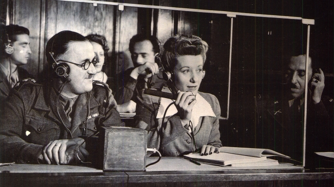 Interpreters providing simultaneous translations at the trials.