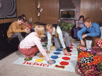 A group of teens playing Twister, circa 1968.