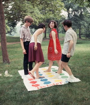 "A group of friends playing a game of ""Twister,"" circa 1966."