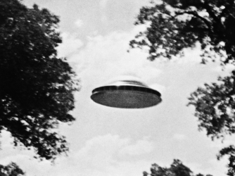 The Amalgamated Flying Saucer Club of America, which headquarters in Los Angeles, released this photo taken by a member reportedly showing a flying saucer estimated at seventy feet in diameter. (Credit:  Bettmann/Getty Images)
