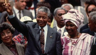 Nelson Mandela stands with his then-wife Winnie, during a visit to New York City. (Credit: Jacques M. Chenet/Getty Images)