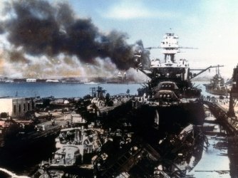 The battleship USS Pennsylvania (center right), sits in drydock at Pearl Harbor, amid the ruins of the USS Cassin and USS Downes, after the Japanese attack, Honolulu, Oahu, Hawaii, December 7, 1941. (Credit: US Navy/Interim Archives/Getty Images)