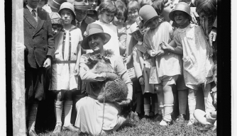 Mrs. Coolidge and Rebecca the raccoon, Easter egg rolling, 1927. (Credit: Library of Congress)
