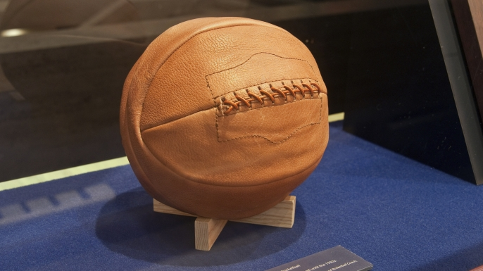 Laced leather basketball, early 20th century, at James Naismith's Original Rules of Basket Ball display. (Credit: Witold Skrypczak/Getty Images)
