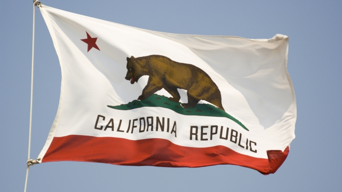 California State Flag, Waving State Banner with Bear and Star. (Credit: YangYin/Getty Images)