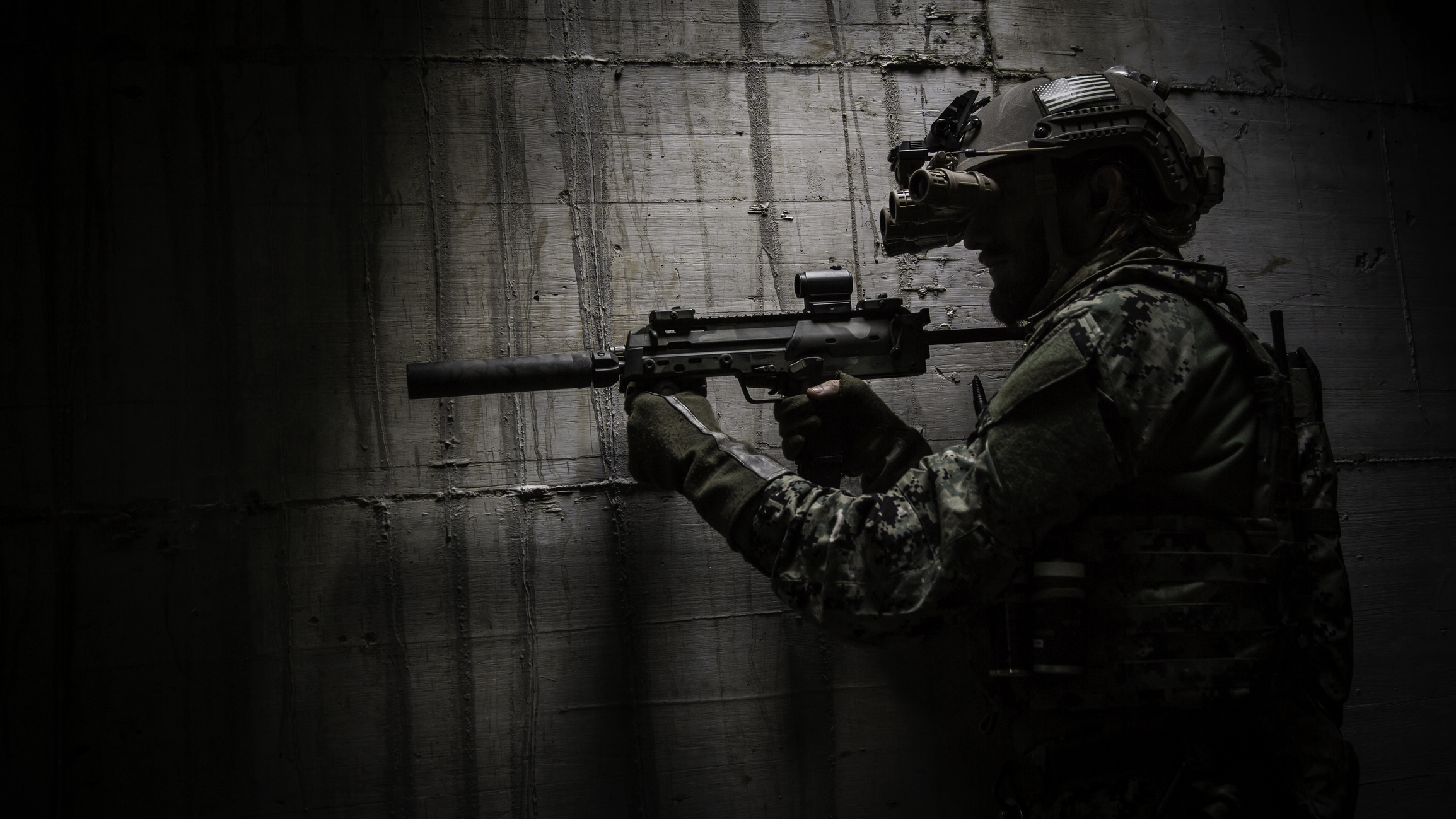 A Combat Ready Special Operation Forces Soldier With MP7 Silenced Submachine Gun And Night