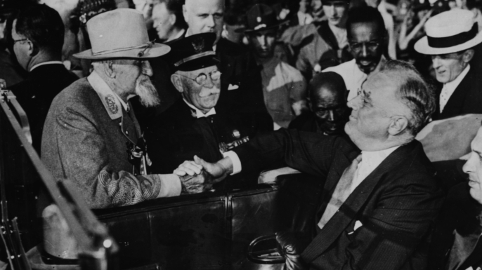 President Franklin D Roosevelt (right) talking to Colonel Vance, an old Confederate veteran from the American Civil War. (Credit: Keystone/Hulton Archive/Getty Images)