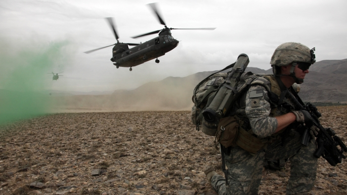 U.S. Army Spc. Kevin Welsh provides security before boarding a CH-47 Chinook helicopter after completing a mission in Chak valley in the Wardak province of Afghanistan on Aug. 3, 2010. (Credit: Public Domain)