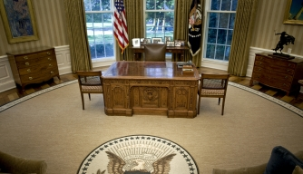 The desk of President Barack Obama sits on top of a new rug in the Oval Office at the White House in Washington, D.C., U.S., on Tuesday, Aug. 31, 2010. (Credit: Brendan Smialowski/Bloomberg/Getty Images)