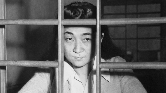 Iva Toguri, better known as Tokyo Rose, has plenty of time for reflection on her crimes here, as she waits in her jail cell in Yokohama for her upcoming trial for treason. (Credit: Bettmann/Getty Images)