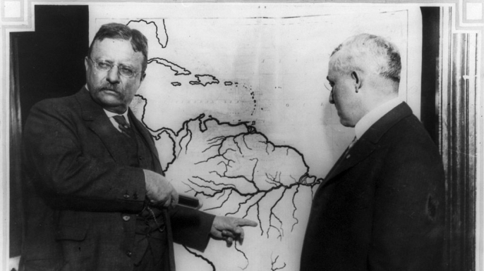 Theodore Roosevelt pointing towards the area explored during the Roosevelt-Rondon expedition. (