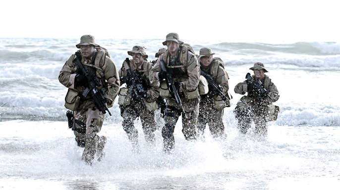 SEAL members training for a beach assault. (Credit: U.S. Department of Defense)