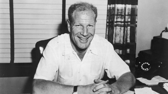 Baseball executive Bill Veeck (1914-1986) seated at his desk, 1965.