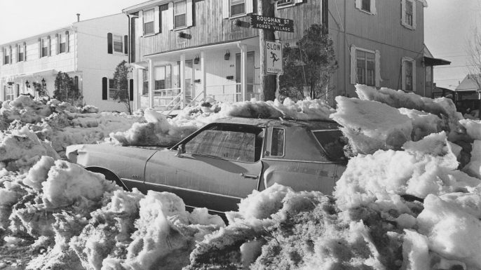 A car covered in snow on a street in Revere, Massachusetts, after a 27-inch snowfall during the Northeastern United States blizzard of 1978. (Credit: Barbara Alper/Getty Images)
