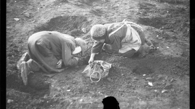 Elderly residents digging for food in the ground, 1940-1944.