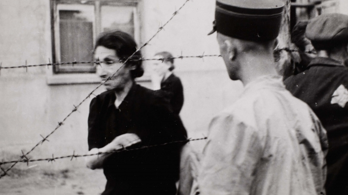 Ghetto police with woman behind barbed wire, 1940-1944, by Henryk Ross. (Credit: Art Gallery of Ontario)