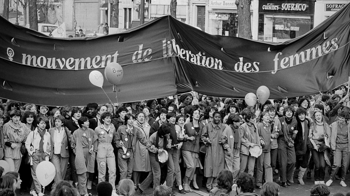 A group of French demonstrators marching under the banner of the Movement for the Liberation of Women (MLF) on International Women's day, 1981. (Credit: Keystone-France/Gamma-Keystone via Getty Images)