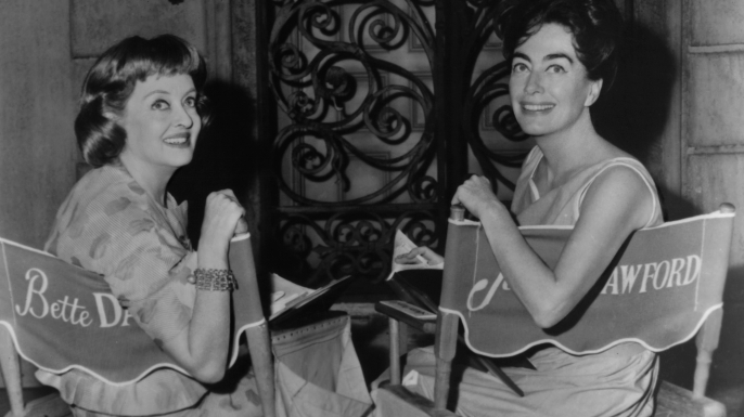 "Bette Davis and Joan Crawford on the set of ""What Ever Happened To Baby Jane?"" (Credit: Warner Brothers/Getty Images)"