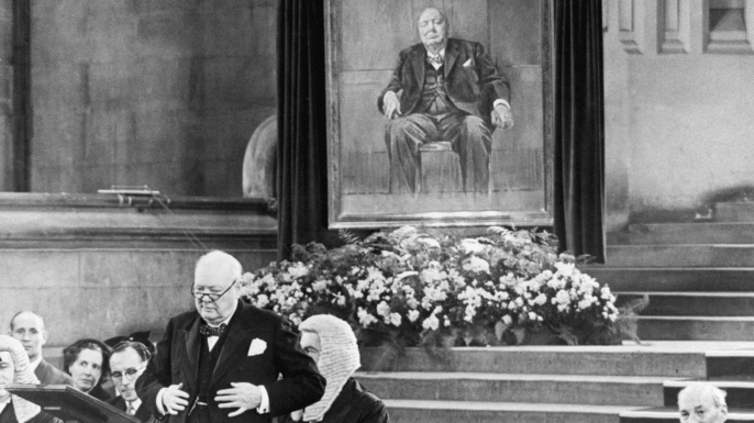 Churchill addresses parliament after receiving the portrait of himself painted by Graham Sutherland as an 80th birthday gift. (Credit: Bettmann/Getty Images)