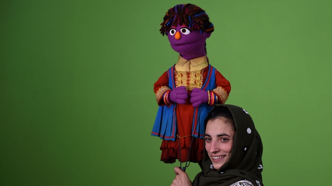 "Afghan puppeteer Seema Sultani holds a muppet named ""Zari"" for a recording of the Afghan show ""Baghch-e-Simsim"", or Sesame Garden."