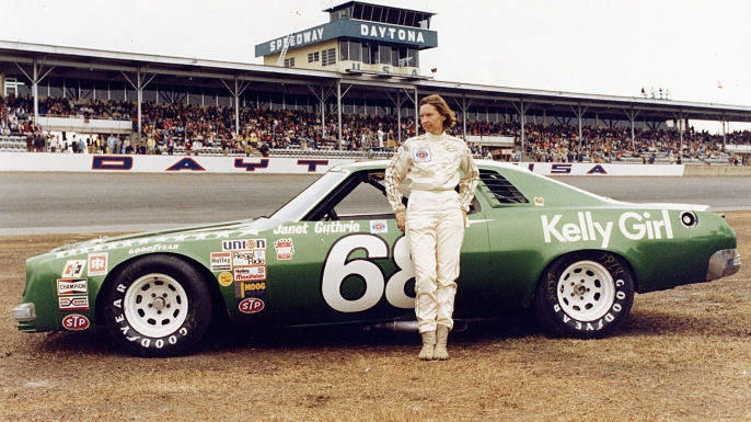 Janet Guthrie #68 stands in front of her car before the 1977 Winston Cup Daytona 500 on February 20, 1977.  (Credit: ISC Archives/Getty Images)