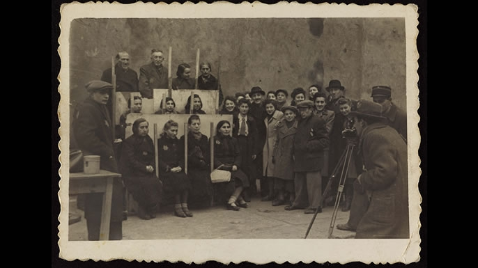 Henryk photographing for identification cards, Jewish Administration Statistics Department c. 1941. (Credit: Art Gallery of Ontario)