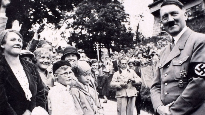 Hitler greeting crowds during a wartime rally. (Credit: C&T Auctions)