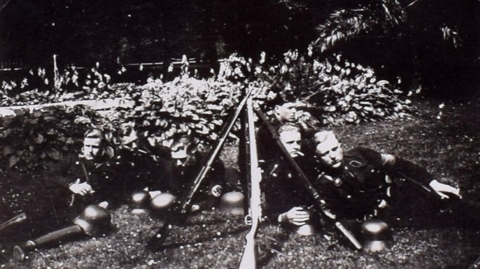 Candid shot of German soldiers relaxing on the grounds. (Credit: C&T Auctions)