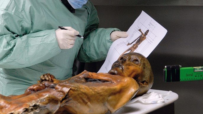 Scientific examination of the frozen mummy. (Credit: South Tyrol Museum of Archaeology/EURAC/Samadelli/Staschitz)