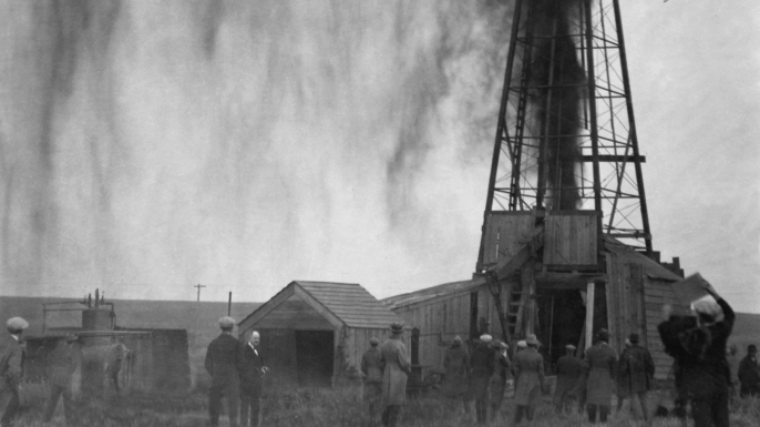 Workers strike oil in Osage territory. (Credit: David Grann)