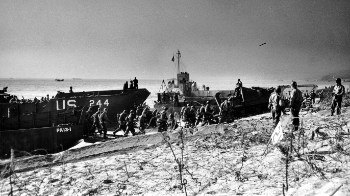 Troops coming ashore Slapton Sands during the exercise. (