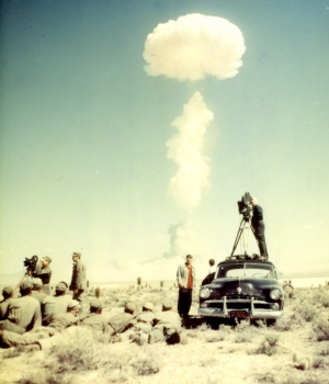 CBS newsreel cameraman and troops watching the atomic bomb test explosion on April 22, 1952.