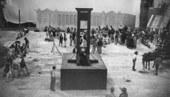 circa 1930:  The guillotine being positioned on the set of the French film 'Danton'.  (Photo by Hulton Archive/Getty Images)