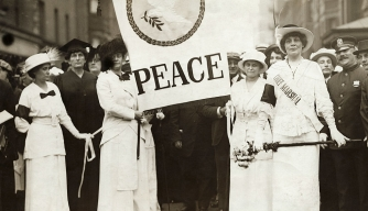 Women carrying peace banner during an international protest against war. (Credit: Bettmann/Getty Images)