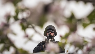 A NATO soldier serving in a peace-keeping led force. (Credit: ARMEND NIMANI/AFP/Getty Images)