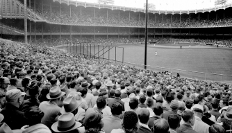 A crowd takes in an MLB game, c. 1947. (Credit: Al Pucci/NY Daily News Archive via Getty Images)
