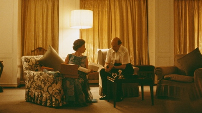 Queen Elizabeth II and Sir Martin Charteris reviewing papers on board Britannia, 1972.