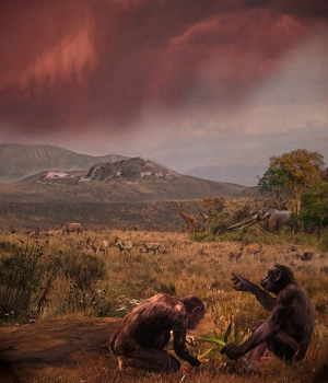 l Graeco (Graecopithecus freybergi) lived 7.2 million years ago in the dust-laden savannah of the Athens Basin. This view from El Graeco's place of discovery, Pyrgos Vassilissis, to the southeast over the plain of Athens and under a reddish cloud of Sahara dust; in the background: Mount Hymettos and Mount Lykabettos. Painting by Chicago-based artist Velizar Simeonovski according to scientific instructions of Madelaine Böhme and Nikolai Spassov.