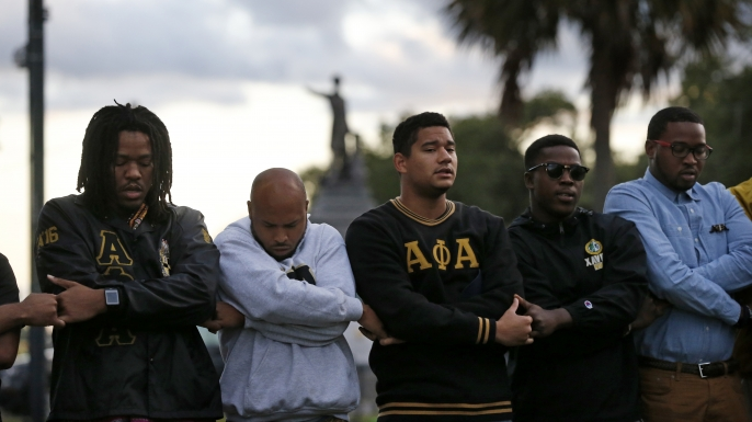 Graduate members of Alpha Phi Alpha Fraternity, Inc. pray during a vigil across the street from the Jefferson Davis monument on May 4, 2017. The group supports the removal of Confederate monuments.