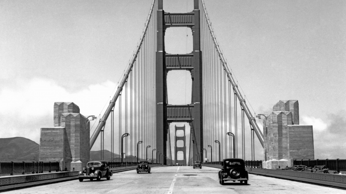 Press cars going across the about to be opened new Golden Gate Bridge, in May 1937. (Credit: Underwood Archives/Getty Images)